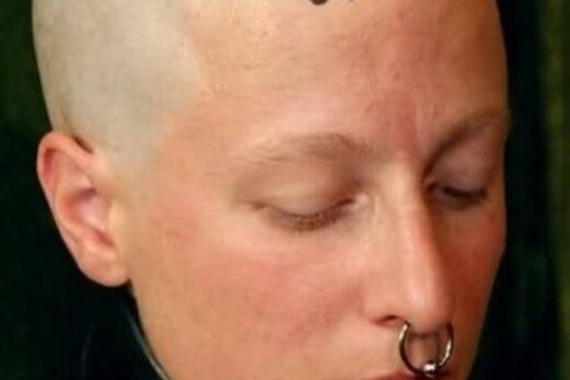 Lisa 0714 slave with shaved head and nose ring and posture collar
